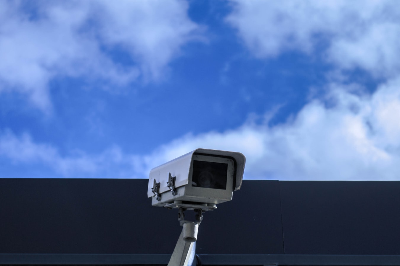 A security camera looking out on the side of a building